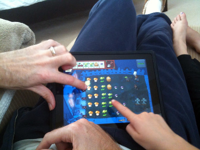 Dmitri and his daughter play a game of Plants vs. Zombies together on the iPad.